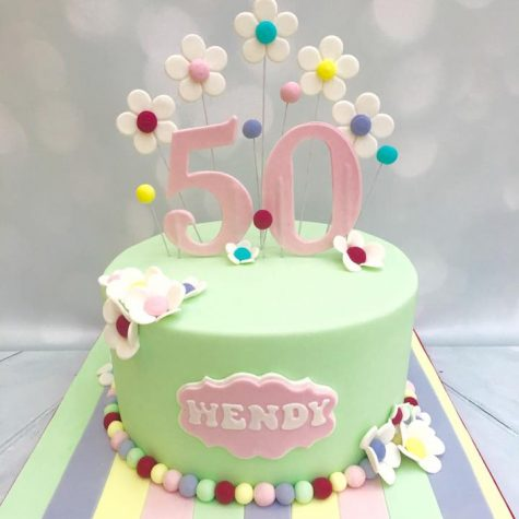 "A pretty floral & pastel triple layer 9"" round cake for a 50th birthday, with candy stripe iced drum"