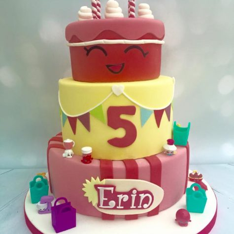 "A bespoke 3 tier 'Shopkins' themed birthday cake, shown as a 10"" 8"" and 6"""