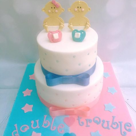 "2 tier twin boy and girl baby shower cake, shown as a 9"" and 7"" round"