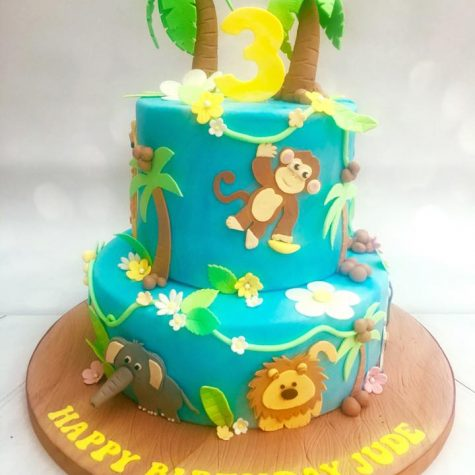 2 tier jungle themed cake with handmade sugar jungle animals & foliage