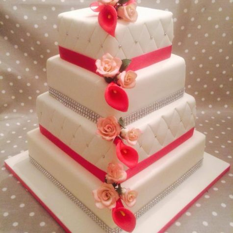 Our latest wedding cake creation....a stunning 4 tier cake with a patchwork quilting effect with handmade cala lily and roses
