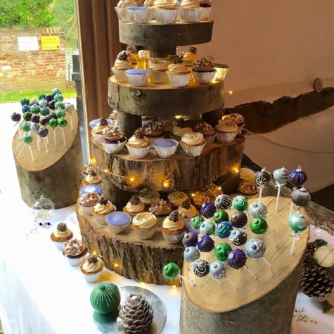 A winter wonderland cupcake table for a December wedding - featuring salted caramel, luxury lemon and chocolate fudge cupcakes with handmade toppers