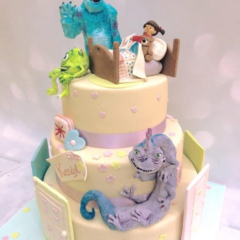 A beautiful, large 3 tier bespoke Disney Monsters Inc cake for an 18th birthday. Mike, Sulley and Randall are handmade in sugar by ourselves, along with other toppers