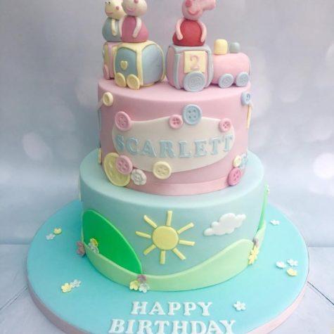 2 tier double barrel Peppa Pig cake, with handmade figures & train