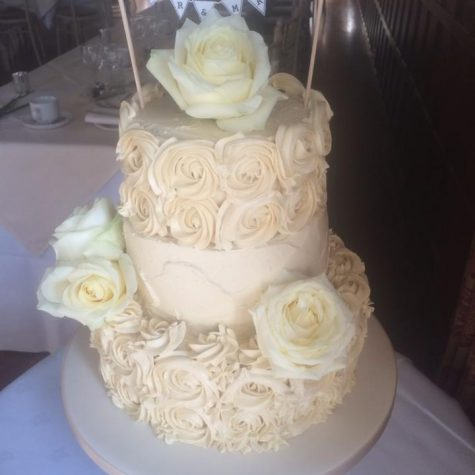 A lovely vintage rose swirl 3 tier wedding cake made for a wedding at Layer Marney Tower