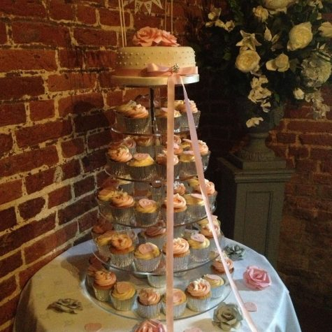 A cupcake tower for a wedding at Leez Priory with pearl dot top tier cutting cake